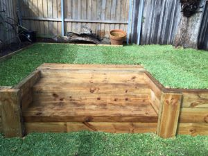wooden retaining wall and lawn care